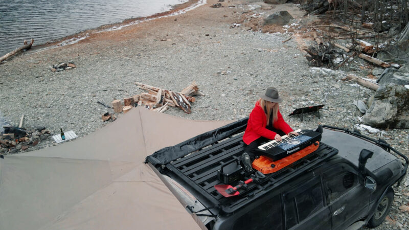 playing the piano on rhino rack landcruiser 100 series overland lady | Overland Lady by Monique Song